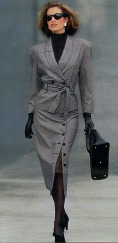 Gray wool suit, double-breasted jacket with tie-belt, mid-calf skirt with button slit, Spiegel catalog, 1989.