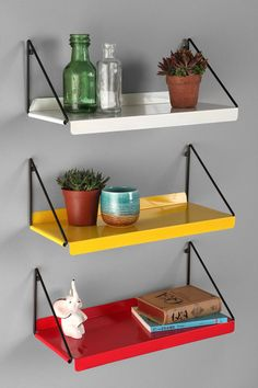 Modern Wall Shelf  #UrbanOutfitters  Awesome for keeping school/ work related items from cluttering my desk!!