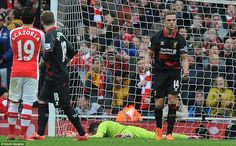 Jordan Henderson pulled one back for Liverpool from the penalty spot after Bellerin brough...