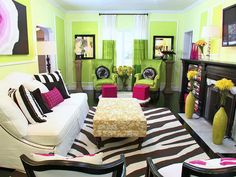 Green, pink and black living room designed by David Bromstad
