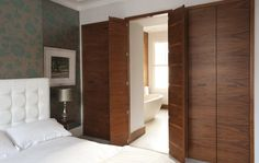Wardrobes with secret door through to en suite bathroom.