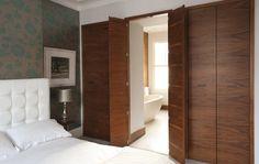 Wardrobes with secret door through to en suite bathroom.