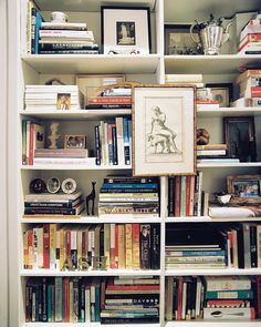 bookcase styling, art on bookcase, vignette styling, collecting