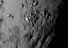 View larger. | Ice mountains on Pluto. Close-up image of a region near Pluto's equator - at the bottom of the heart region, which is now being called Tombaugh Regio. These mountains - which are
