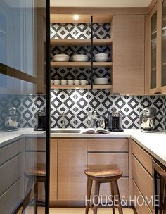 Designer Nam Dang-Mitchell carried light wood cabinetry into the pantry area of this Vancouver kitchen and paired it with graphic tile. | Photographer: Janis Nicolay
