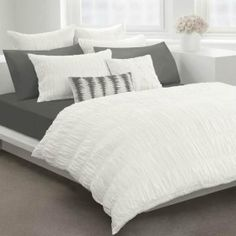 Detailed white duvet for guest room. Just need some printed sheets to peep from underneath!