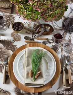Aerin Lauder sets an Austrian-inspired woodland fantasy table with heirlooms, such as antique stoneware pitchers and vintage Austrian linens, with new pieces from her collection, like wood chargers that recall the rich grain in vintage skis | Charger, plates, and glassware, Aerin for Lenox.