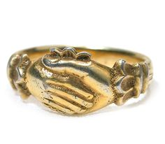 Another Fede ring, silver gilt circa 1650