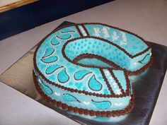 Paisley Horseshoe - Horseshoe birthday cake in Teal and Chocolate brown with white trim.  All buttercream and chocolate cake.