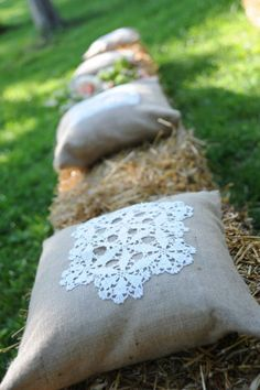 Hand made burlap pillows with vintage lace doily applique for hay bale seating - by Cedarwood Weddings. Photo by Ace Photography.