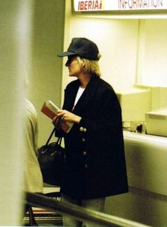 Princess Diana, trying to hide and find privacy.