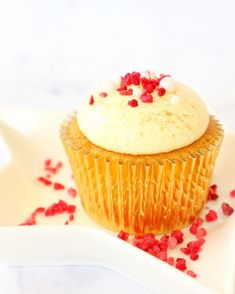 A vanilla cupcake, filled with raspberry goo infused with Chambord liqueur, topped with lemon buttercream and finished with edible gold,… Chambord Liqueur, Lemon Buttercream, Vanilla Cupcakes, Raspberry, Desserts, Gold, Vanilla Bean Scones, Deserts, Raspberries