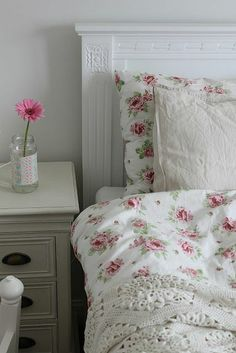 soft florals and mixed textures. shabby chic inspired bedroom.