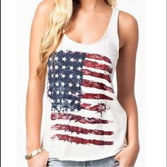 "American Flag Tank Top American Flag Tank Top. Runs small. Bust is 34"". Length from shoulder to bottom is 20""  New in package Tops Crop Tops"