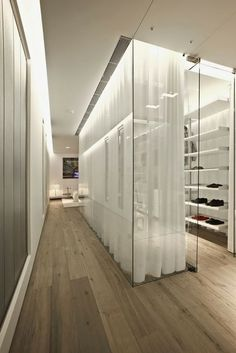 glass wall w/ sheer white curtains for office