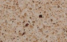 "Original name: 9205 Savannah |  Material: Quartz | Pattern: Speckles | Colors: Brown, Gold, White | Application: Kitchen, Bathroom, Fireplace, Floor, Outdoor | Comments: CaesarStone line of artificial stone is made from 93 percent natural quartz and 7 percent polyresin. ""Savannah"" is a light tan quartz with consistent brown speckling. All slabs are polished and cut 1 1/4 thick."