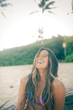 Malia Manuel, face framing highlights enhance this natural, beachy look