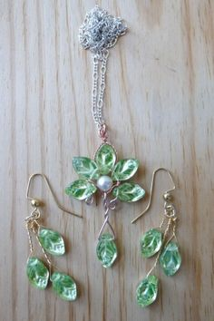 This beautiful fairytale jewelry set is inspired by the home of the Elves in the Lord of the Rings.This variation on my popular Evenstar necklace and Enchanted Forest Earrings features dazzling Czech glass that is a shiny, iridscent green/pink/gold on one side and a light foresty green on the other.The pendant is 2 inches tall and comes on a 16 inch chain. The earrings are an inch and a half long.