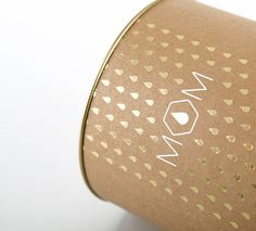 pattern is delicate and subtle, logo treatment is light