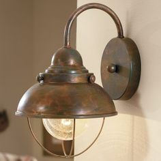 Weathered copper sconce.