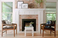 This is what I want to do to our ugly 80s fireplace. Whitewash our dark brick and then add a nice white mantle and surround. Gorg and still has the old house feel.
