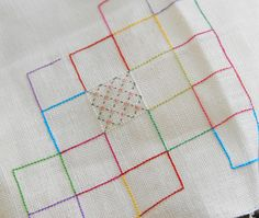 she stitched some of her grid first... used the same stitch with different colors