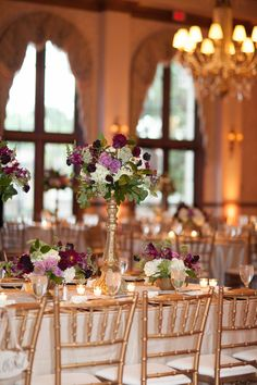 details of the king table at reception included tall vintage gold pedestals flanked by antique brass containers filled with lavender roses, burgundy scabiosa, white hydrangea, burgundy snapdragons, queen anne's lace, burgundy dahlia and lemon leaf.