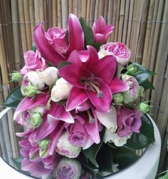 vintage bouquet with striking pink liliums added