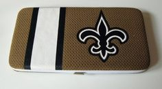 New Orleans Saints Football Jersey Clutch Shell Wallet by Little Earth. $16.99. The Shell Mesh Wallet can function as a mini purse for a dinner out or a wallet that goes into a larger bag. Full of features such as 5 credit card pockets clear ID sleeve zip change pocket and two full-length pockets this wallet is a winner at the game or any time!