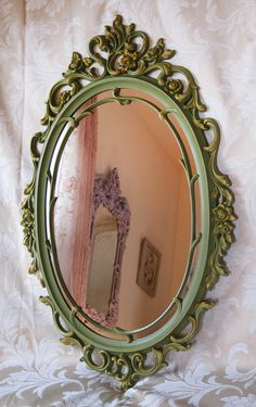 Syroco Oval Wall Mirror Vintage Ornate Olive Green Orange Hollywood Regency Victorian. $145.00, via Etsy.