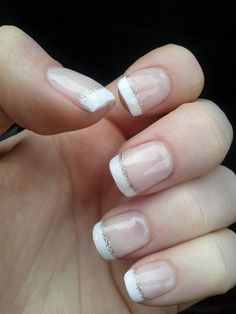 A twist on the classic french tip. A line of silver sparkles. I felt a little Bridal wearing them.