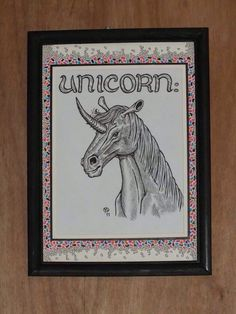 UNICORN A varient on the unicorn theme all set in a hand-decorated border