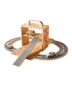 Carry and go! This transportation set includes three wooden cars with tracks and ramps for building a road system. After a day of driving, the cars and roads pack up neatly into the parking garage.Includes three vehicles, 10 road tracks, 10 connectors and storage case8'' W x 9'' H x 4.5'' DWood