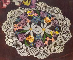 crochet doily with flowers