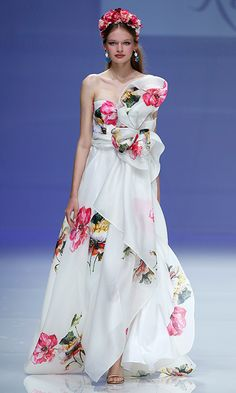 Designer Alejandro Resta showed his love of florals once again in an ultra-feminine design with asymmetrical flourish.