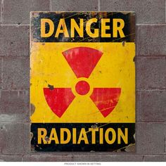 This Danger Radiation Metal Sign looks great in a home bar or dorm room. This atomic age sign warns of nuclear radiation and makes a fun gift for any fan. Made of 24 gauge steel in the USA. Halloween Science, Halloween Post, Halloween Office, Halloween Projects, Halloween 2017, Halloween Ideas, Military Signs, Gallows Humor, Arte Robot
