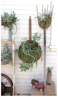 Old rusty tools as containers: Line the tool opening with moss or coconut fiber before filling with soil and plants