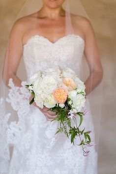 A bouquet of garden roses and jasmine wrapped with a handkerchief | @allymagdaphoto | Brides.com