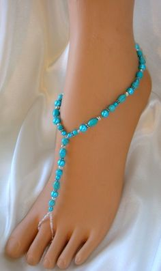 imeless Turquoise Foot Jewelry in every girls purse to slip them on for instant Beautiful Bare feet. The picture shows the perfect selection of unquic Turquoise peices accented with Antique and Sterling Silver. Each pair of Barefoot Sandals are custom made in many colors in just your sandal size. Destination Beach Wedding or Garden Wedding Foot Jewelry for the most elegant Bride and her Bridesmaids Just lovely with lingerie.
