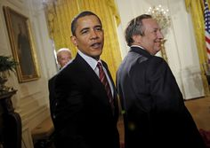 President Barack Obama, with Director of the National Economic Council Lawrence Summers, greets supporters after an East Room ceremony launching a new task force chaired by Vice President Joseph Biden dedicated to raising the living standards of middle class Americans, at the White House in this 2009 file photo.