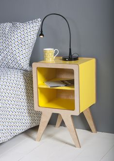 """Obi furniture's """"Space"""" bedside table in Birch plywood and yellow lacquer."""