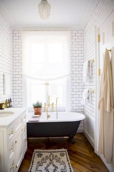 I like the subway tiles and tub but it's too white. Paint the ceiling.