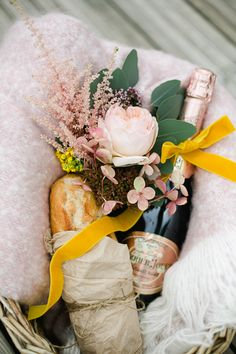 flowers, champagne + baguette