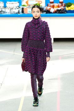 Chanel. Fall 2014. Bouclé tweed dress/tunic with shiny, sparkling leggings, all in lilac, with mint and yellow coloured chic sneakers.