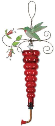 Red hummingbird feeder is decorated with a metal hummingbird and flower.