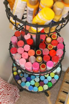 Great craft room space. Acrylic paint tubes get the perfect home in this tiered basket stand . Group by color, and all flipped upside down, they are easy to find, and pretty to look at! Lots of open shelving, perfect for displaying a collection of craft items, or collectables. Simple and cheap ikea shelving! Theraggedwren.blogspot.com