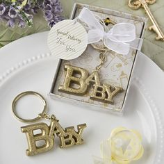 Luxurious Gold Baby Themed Key Chain From Fashioncraft- Let your guests keep their memories of your baby shower or christening party close to their hearts when they attach this glorious golden Baby charm to a bunch of keys. A luxurious charm with the Cheap Baby Shower Favors, Baby Shower Themes, Baby Shower Decorations, Baby Shower Gifts, Baby Theme, Shower Ideas, Safari Theme, Christening Party Favors, Biscuit