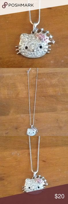 HELLO KITTY LARGE CRYSTAL NECKLACE & PENDANT Hello Kitty crystal necklace.  Excellent condition, classic and pretty!  Great Christmas gift!  Will ship right away.  Check out my other designer items Hello Kitty Jewelry Necklaces