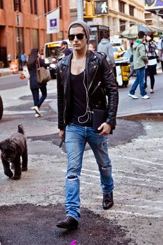 The look is seemingly effortless, which somehow makes it work well.  The black motorcycle jacket looks great open over a black deep cut tank top.  The tattered straight leg jeans work well over boots.  The grey beanie and the sunglasses tie it all together.  Shop Mens Beanies at neffheadwear.com
