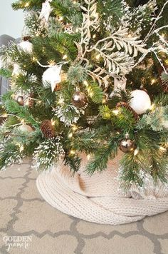 Neutral glam Christmas tree with knitted scarf tree skirt